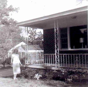 1950s - Mary Sharpe outside home